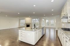 The kitchen has a dining area and opens into the family room