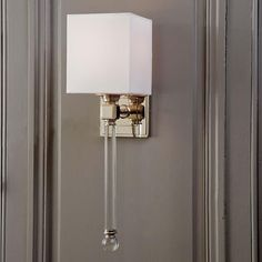 Modern Crystal Sconce. Perfect for the Dining Room. Maybe continue along the wall in the formal living as well?
