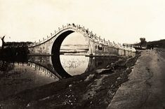 © Thomas Child, ca. 1870s, Jade Belt Bridge, BeijingThis is an early photograph of Jade Belt Bridge, or Moon Bridge, located on the grounds of the Summer Palace in Beijing on the western shore of Kunming Lake. The elegant high arch bridge is a traditional Chinese design. The arch was constructed high enough to allow passage of the Emperor's dragon boat. On special occasions the Emperor and Empress travelled on Kunming Lake passing under this bridge.Find more photos from the 1870s here.