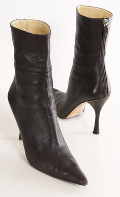 Gucci brown pointed-toe boots. Wear these boots with your favorite dress or under a great pair of jeans.
