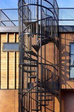 exterior by Dan Nelson A.I.A.   Designs Northwest Architects/Spiral Staircase leads from first floor to Roof Deck/Seattle Floating home...