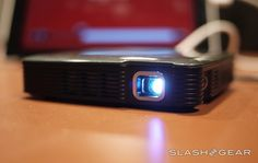 It's time to get giant with the Brookstone HDMI Pocket Projector, the newest fun and entertaining light pusher on SlashGear's own review bench! This device connects to whatever device you've got on hand that can push images via HDMI, with a set of controls that so simple to understand, you'll not need to peek at the instructions even once. What we've got a demo of here is the device working with an iPad – but the limits of your HDMI-connected greatness are up to you!
