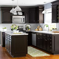 Transform Your Cabinets Use Rust-Oleum Cabinet Transformations (#340517) to give existing cabinets a fresh color and finish without stripping, sanding, or priming in only about a week. Choose from several colors -- we went with dark and handsome Kona. You can also stack crown moulding above upper cabinets to make them look taller and to visually lift the height of the ceiling.