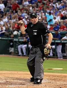 Image result for Major League Baseball umpires often wear black underwear, in case they split their pants.