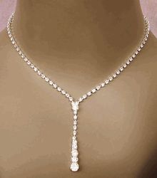 Sexy Drop Rhinestone Jewelry Set. I don't think I'm getting the earrings, or at least won't wear them, but I'm in LOVE with the necklace!