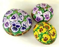 How to Paint Whimsical Flowers on Rocks - Pansy Painting Garden Stones · Creativity-Portal.com
