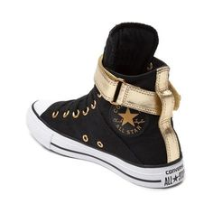 The new Chuck Taylor All Star Brea Hi Sneaker from Converse rocks signature hi-top design with street ready style. Go glam with the All Star Hi Brea Chucks, featuring a metallic, wraparound ankle strap atop durable canvas uppers, and gold-tone eyelets with signature Chuck Taylor logo patch. <b>Only available at Journeys and SHI by Journeys!</b>  <br><br><u>Features include</u>:<br> > Hi-top style constructed with durable canvas uppers<br> > Synthetic leather, wraparound ankle strap with…