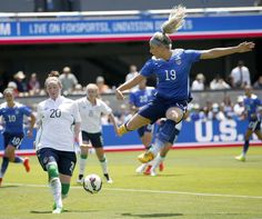 United States' Julie Johnston (19) shoots on goal as Ireland's Fiona O'Sullivan (20) defends during the first half of an exhibition soccer match...