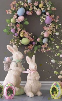 Colorful Easter decorations with ceramic bunnies, colored eggs, and flowers