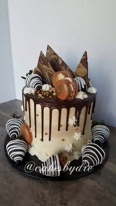 Coffee Drip cake with chocolate covered strawberries and macaroons
