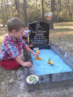 """Family added a sandbox to their baby's grave so big brother could """"play with"""" him when they visit the cemetery."""