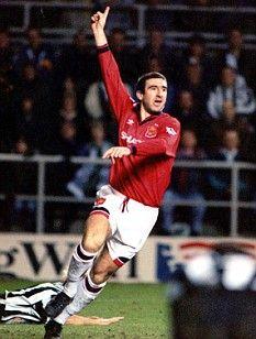 Eric Cantona celebrates scoring the winner at Newcastle in 1996