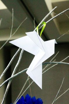 My son's First Communion origami dove - I made a LOT o these!  The dove represents the Holy Spirit for catholics, so a I used this symbol as the main theme of the celebration