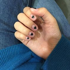clear nails with minimal black heart design, minimal heart design on nails,