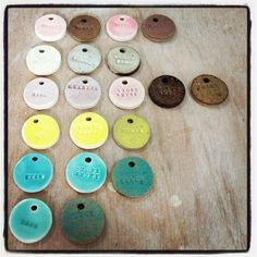 glaze test tiles: use stamps to write the color as well as see how the glaze breaks the surface.