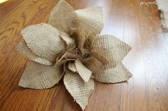 Burlap flower DIY. This would be super pretty on a headband. :)