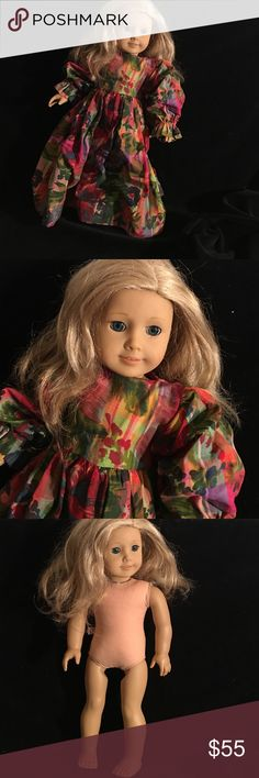 AMERICAN GIRL DOLL VERY GOOD CONDITION AMERICAN GIRL DOLL  HAS HER STRINGS. WEARS A DRESS. BLUE EYES. NOT DAMAGED AMERICAN GIRL Other