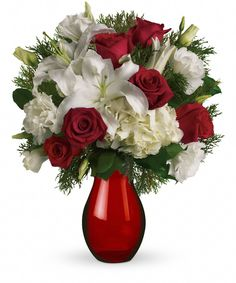 Christmas Kiss - The picture of holiday romance. Beautiful white hydrangea and rich red roses fill our stunning red glass royal vase.