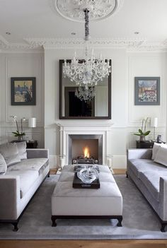 White and grey living space. Love the sofas facing each other with the ottoman in the middle. Stunning!