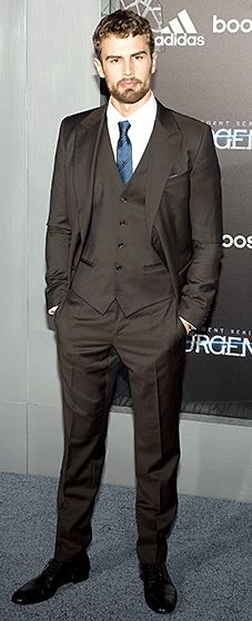 The clean-cut actor looked hot in a Dolce & Gabbana three-piece suit, paired with a royal blue and black striped tie.