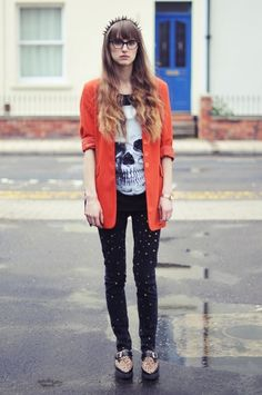 Gold Studded Jeans, Spiked Headband. Skull Tshirt. Orange Blazer