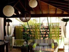 tropical exterior by Inner Plan Design Studio Ltd