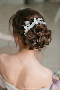 long wavy bridal updo hairstyle via katerina andreeva / http://www.himisspuff.com/beautiful-wedding-updo-hairstyles/9/
