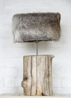 Faux fur lampshade and tree trunk base. #Unique #Decor.
