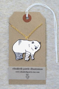 """When I saw this, I thought, """"What a cute idea, to wear a decorated tag as a pendant necklace!"""" So, okay, I saw it wrong, but I still like the idea, lol. (polar bear pendant by elizabeth pawle modern by ElizabethPawle, $28.00)"""