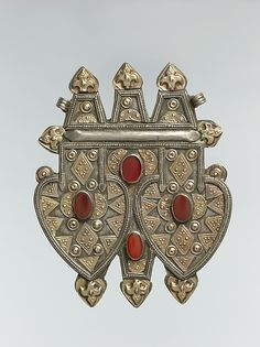 Double cordiform pendant. Date: late 19th–early 20th century. Geography: Central Asia or Iran. Culture: Islamic. Medium: Silver, fire-gilded, with applied.