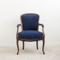 Hillary Chair: Hillary's deep velvet upholstery is perfectly accented by her feminine curved wood frame. She's a wonderful option for seating at a sweetheart table for the groom, but she looks equally lovely in a lounge area.