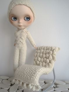 Blythe dolls CAN be cool, but this one looks sort of creepy. I do love the tiny knitted chair.