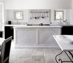 Limestone Floors with the marble island is killer pretty