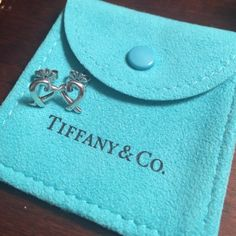 FINAL FLASHTiffany Paloma Picasso earrings in awesome condition, just one earring a little bent (see photo). original earring backs included. comes with Tiffany's pouch, box, AND bag. third photo shows authenticity. bundle and save! Tiffany & Co. Jewelry Earrings