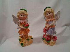 "set of (2) Hard Plastic Summertime Young Girl Angle Figurines. Their soft and colorful pastel colors, along with their sparkling wings truly catch your eye. The angles are holding red roses, while standing in a flower patch. They are in Excellent condition with no nicks, chips, cracks or stains. There are no maker's marks. The bottoms have been numbered. I believe by their original owner.   They measure 6"" tall x 2 ¾"" long and 2"" deep."