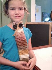 Knitted flute case using wool yarn dyed over the course of her kindergarten year.