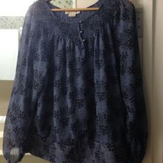 Michael Kors top Blue & black patterned frocked on collar small silver buttons. Tie sided bottom. Very cute. Good for Spring or summer KORS Michael Kors Tops Blouses