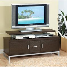 @Overstock - Showcase your TV with this red wood TV cabinet while you store DVDs and other media. The red cocoa finish on the wood fits in well with a variety of styles and this TV stand allows you to showcase your media in both casual and swanky settings.http://www.overstock.com/Home-Garden/Grande-Red-Cocoa-48-inch-TV-Cabinet/5735831/product.html?CID=214117 $148.49