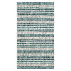 """• Machine loomed Polypropylene<br>• Weather-resistant outdoor/indoor quick-dry<br>• Low pile (Less than 0.5"""")<br>• Fully serged edging<br><br>Decorate with the Safavieh Dudley Outdoor Rug and you'll have the best-dressed deck or patio in town. The stripe pattern will be the highlight of any décor from contemporary to traditional. This area rug makes your outdoor setting super comfy and cozy."""