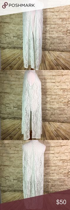 """LuLaRoe Joy Long Vest Lace Mint Green Name Brand: Lularoe  Condition: New With Tags  Size: Medium (see measurements)  Color: Mint Green  Style:  Joy Long Vest  Material: Nylon Blend  Always check the measurements, label sizes are not consistent.  Measurements are approximate, and are of item laying flat and unstreched: Length: 44"""" Bust: 25"""" LuLaRoe Jackets & Coats Vests"""