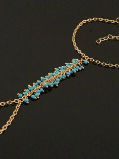 Accessories // Complete that chic bohemian look by adding this gold turquoise beaded slave bracelet.