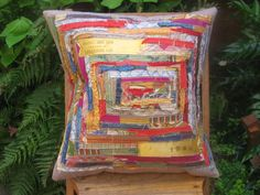 pillow made with old horse show ribbons, if I knew how to sew I'd make this ASAP...