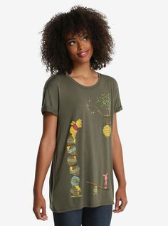"Pooh bear gives no bothers when it comes to the pursuit of honey. Piglet on the other hand... This super cute olive green tee features the pair attempting to get some honey out of a hive. <br><ul><li style=""list-style-position: inside !important; list-style-type: disc !important"">65% polyester; 35% rayon</li><li style=""list-style-position: inside !important; list-style-type: disc !important"">Wash cold; dry low</..."