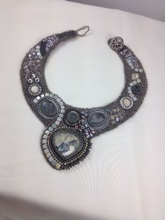This statement collar is one-of-a-kind, handmade, bead embroidery created in tones of gray and taupe. The photo is for special order ideas
