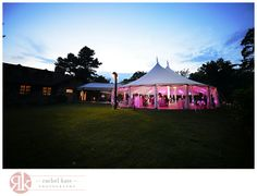 A view of the Sperry Tent at Willowdale Estate with uplighting from Design Light and custom Tent Drapes from Revelation Productions.