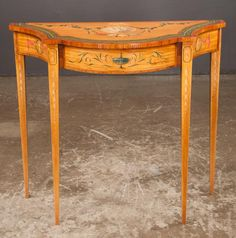 Satinwood bow front console table with hand painted floral s