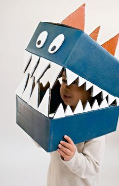 Cardboard boxes can quickly become this amazing DIY dinosaur costume. Cardboard boxes can quickly become this amazing DIY dinosaur costume. Cardboard Costume, Cardboard Box Crafts, Cardboard Crafts, Cardboard Mask, Cardboard Playhouse, Cardboard Furniture, Kids Dinosaur Costume, Dino Costume, Diy Halloween