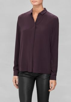 This classic silk shirt features a sophisticated straight fit for a versatile look.