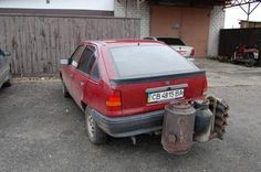 Ukrainian Drivers Are Converting Their Cars into Wood Burners to Save Money on Gas - http://www.odditycentral.com/auto/ukrainian-drivers-are-converting-their-cars-into-wood-burners-to-save-money-on-gas.html