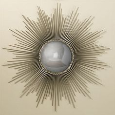 A convex center mirror is surrounded by brilliant rays of nickel, creating an elegant sunburst shape. This wall mirror makes a refined statement and is a true classic! Color: nickel w/convex mirror Size: Dia: • D: (overall) Dia: (reflective area) Sun Mirror, Brass Mirror, Convex Mirror, Mirror Art, Midcentury Modern, Chandeliers, Decor Interior Design, Interior Decorating, Decorating Ideas